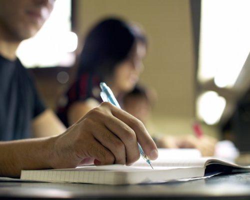 depositphotos_25399091-stock-photo-young-man-doing-homework-and